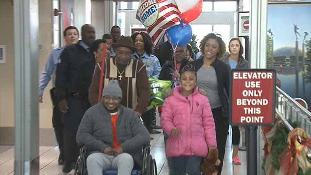 Officer Glasby and his family as he returned home Wednesday. Credit: KMOV