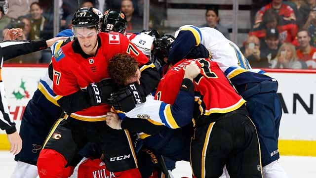 Mark Jankowski #77 and Garnet Hathaway #21 of the Calgary Flames get into a post-whistle scrum against the St. Louis Blues during an NHL game on December 20, 2017 at the Scotiabank Saddledome in Calgary, Alberta, Canada. (Getty Images)