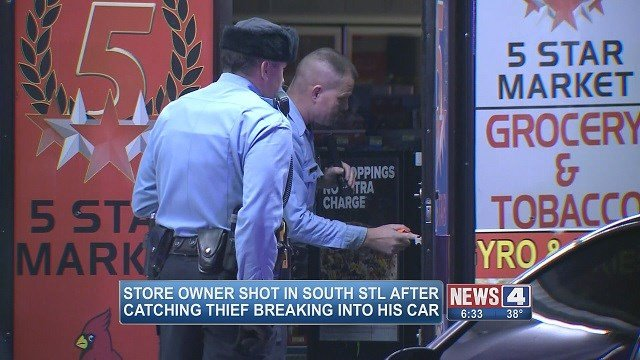 Crime scene investigators review the scene of the shooting at 5 Market Kitchen and Grocery on South Broadway. (Credit: KMOV)