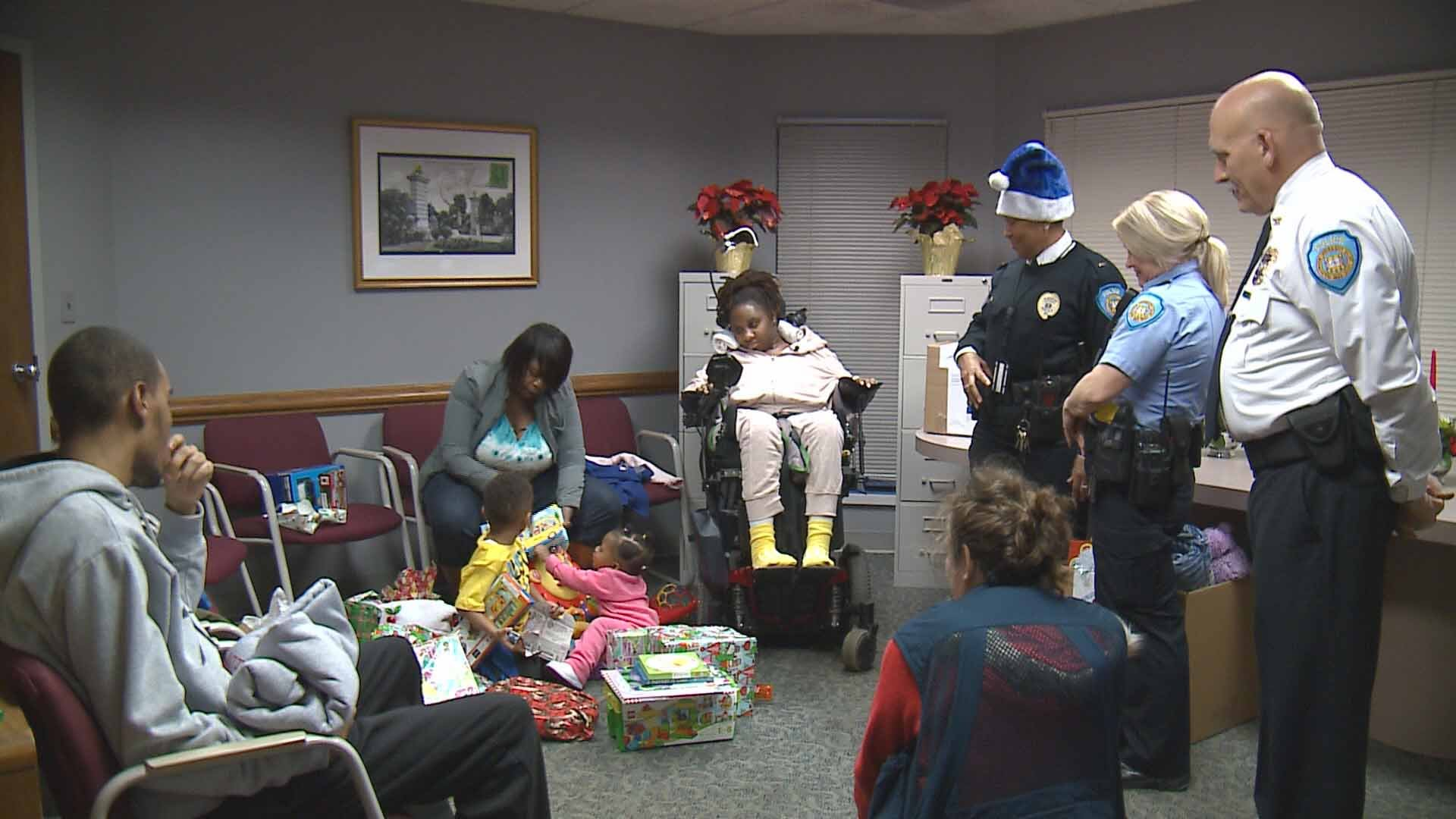 Blue Santa, a friend of the Washington University Police Department, delivered loads of toys, boxes of food and plenty of gift cards to Collier and her two children. Credit: KMOV