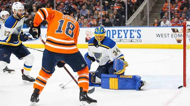 Ryan Strome #18 of the Edmonton Oilers takes a shot on goaltender Jake Allen #34 of the St. Louis Blues at Rogers Place on December 21, 2017 in Edmonton, Canada. (Photo by Codie McLachlan/Getty Images)