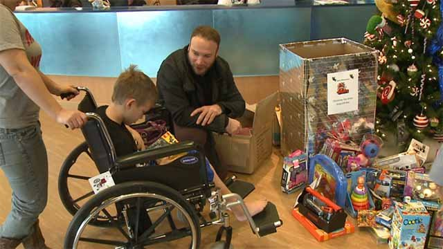 St. Louis native and former Blues enforcer Cam Janssen is teaming with Hans Wiemann to spread holiday cheer to patients at Shriners Hospital for Children. Credit: KMOV