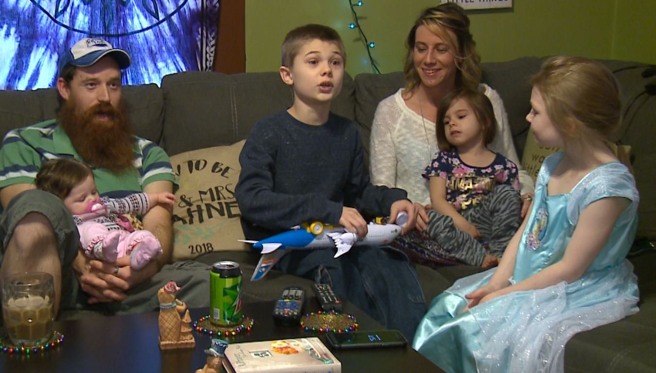 Chris Hahne, left, and Jessica Marek, right, took in their friend's young children while she is hospitalized. (Credit: KMOV)