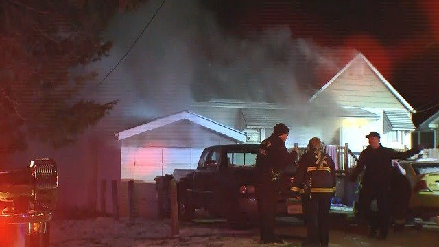 A fire broke out in a home on Mayfair Drive in North St. Louis County on Tuesday morning. (Credit: KMOV)