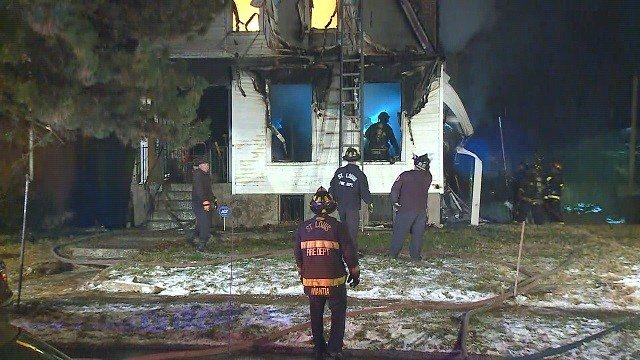 A fire broke out in a home on Horton Place in North St. Louis on Monday night. (Credit: KMOV)