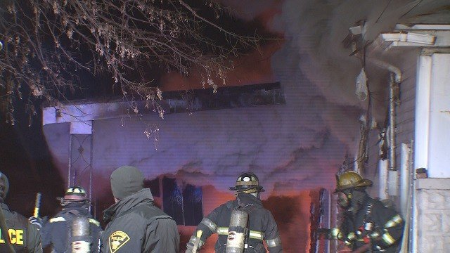 Firefighters work to extinguish a vacant house fire on Jerome Lane in Cahokia. (Credit: KMOV)
