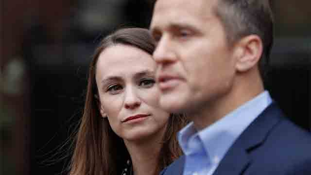 Sheena Greitens, left, listens as her husband, Missouri Gov.-elect Eric Greitens, speaks during a news conference Tuesday, Dec. 6, 2016, in St. Louis. (AP Photo/Jeff Roberson)
