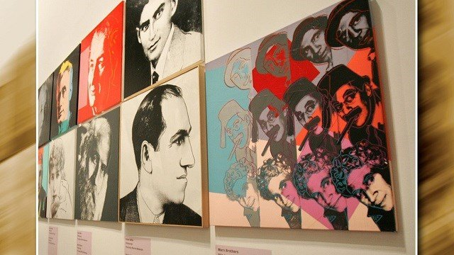 Paintings by artist Andy Warhol on display at the Grand Palais in Paris, France. (Credit: AP Images)