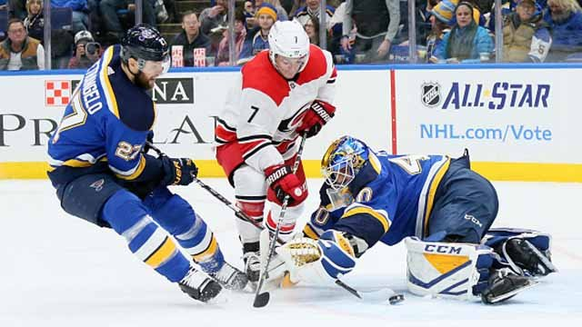 Carolina Hurricanes' Derek Ryan, middle, scores an unassisted goal while being defended by the St. Louis Blues' Alex Pietrangelo and goaltender Carter Hutton in the second period on Saturday, Dec. 30, 2017, at the Scottrade Center. Credit: Getty Images