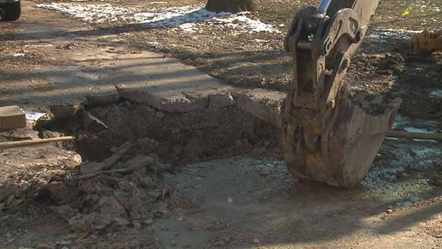 A Hazelwood homeowner was left with a hole in the driveway after a water main broke on New Year's Eve. Credit: KMOV