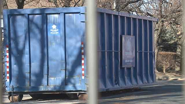 St. Louis police are investigating after a body was found in a dumpster near downtown St. Louis on New Year's Day. (Credit: KMOV)