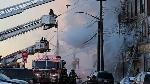 Officials say over 200 firefighters responded to the blaze at a four-story building near the Bronx Zoo. (Credit AP)