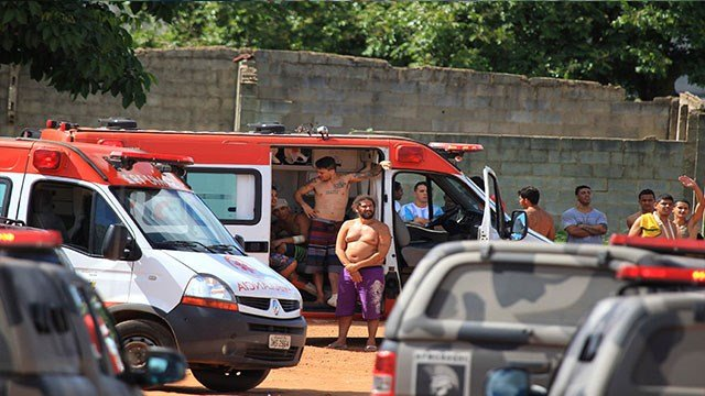 Injured prisoners receive medical care in an ambulance after a rebellion at the Colonia Agroindustrial prison in the Aparecida de Goiania Complex in the state of Goias, Brazil, Monday, Jan. 1, 2018. (Claudio Reis/O Popular via AP)