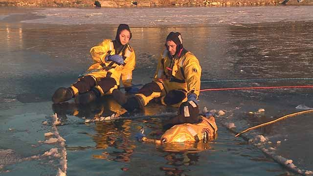 Firefighters showing our own Alexis Zotos what they do to rescue someone from a frozen pond. Credit: KMOV