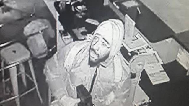 Surveillance photo of a suspect accused of burglarizing a business in Velda City on New Year's Day (Credit: Velda City PD)