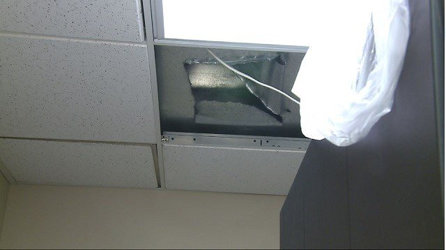 A sprinkler busted in the floor above the Miller Group causing water to leak through the ceiling and onto their computer equipment. (Credit: KMOV)