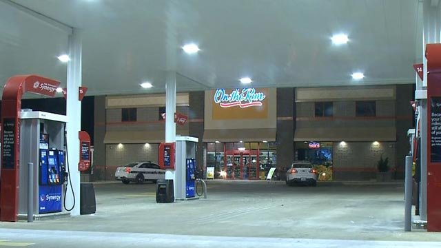 Ballwin Police cars outside the Mobil on the Run after an SUV was stolen Friday (Credit: KMOV)