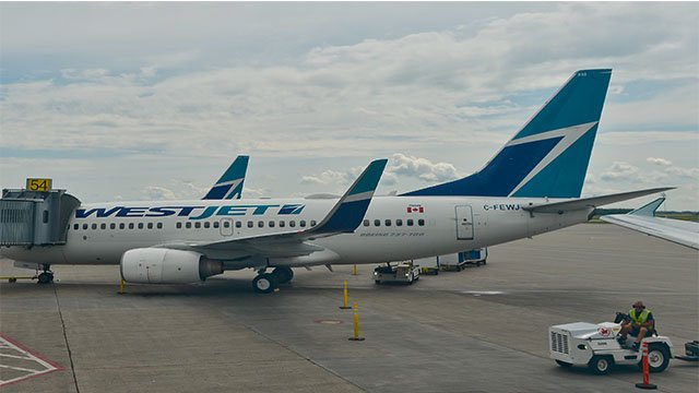 A view of WestJet plane at Edmonton Airport International Airport. On Wednesday, 20 July 2016, in Edmonton, Canada. (Photo by Artur Widak/NurPhoto via Getty Images)