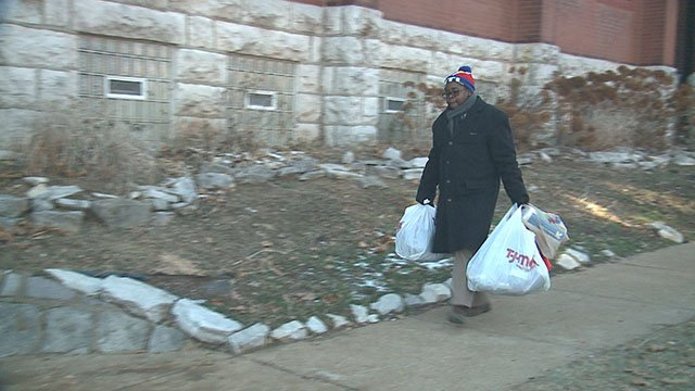 Volunteer takes goods to St. Peters AME Church ( Credit: KMOV)