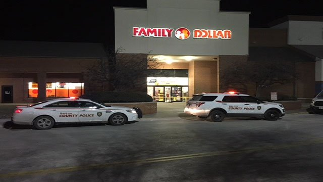 St. Louis Count police investigate an armed robbery at Family Dollar in Florissant ( Credit: KMOV)