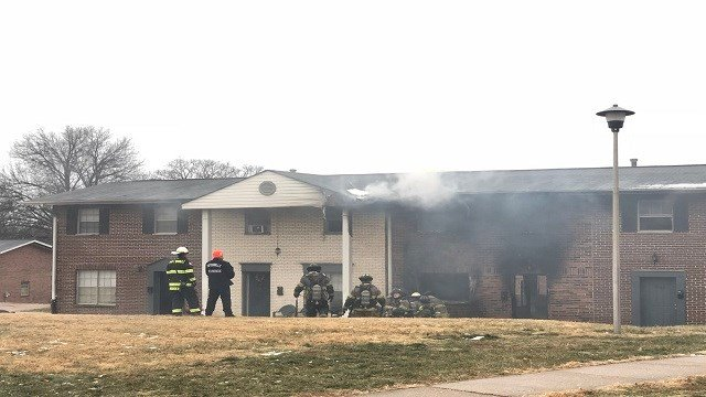 Crews are battling a North County apartment fire in cold, wet, and windy conditions Sunday afternoon. (Credit: KMOV)