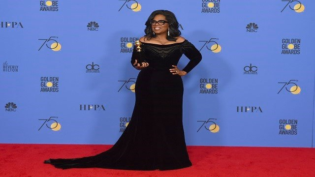 Oprah Winfrey poses in the press room with the Cecil B. DeMille Award at the 75th annual Golden Globe Awards at the Beverly Hilton Hotel on Sunday, Jan. 7, 2018, in Beverly Hills, Calif. (Credit: AP)