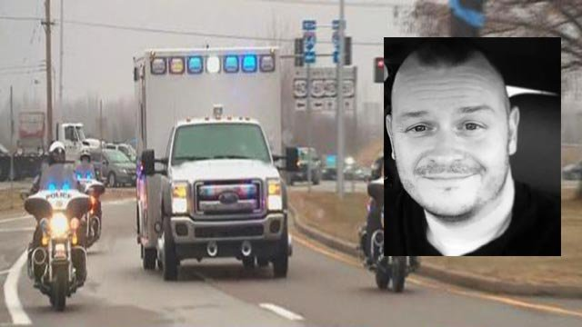 Ambulance carrying Ofc. Ryan O'Connor to the airport Monday (Credit: KMOV)