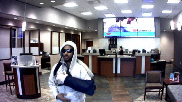 Officers from the Edwardsville Police Department are searching for a suspect who robbed a local bank wearing a blue arm sling. (Credit: Edwardsville PD)