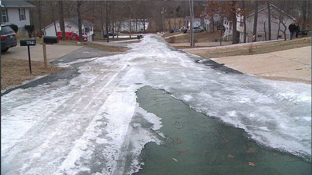A water main break turned a Hillsboro road into a sheet of ice ( Credit:KMOV)