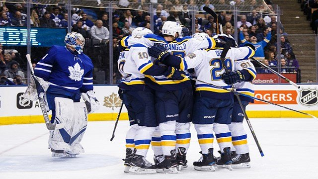 Members of the St. Louis Blues celebrate a goal by Alexander Steen #20 as Frederik Andersen #31 of the Toronto Maple Leafs skates in his crease during the third period at the Air Canada Centre on January 16, 2018 in Toronto, Ontario, Canada. (Photo by Ke