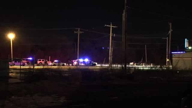 Police say a suspect who led them on a bi-state chase has barricaded himself inside a car in Brooklyn, Illinois. Credit: KMOV