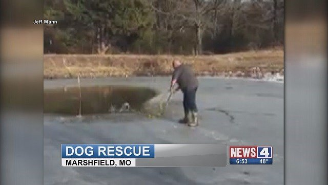 A man rescues his neighbor's dog after it fell in a frozen pond. (Credit: Jeff Mann)