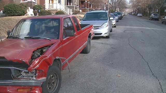 Two Tower Grove South families woke up to find big damage to their cars after a hit-and-run crash. Credit: KMOV