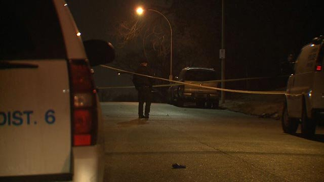 Crime scene investigators in the 4400 block of Anderson after two people were shot Monday (Credit: KMOV)
