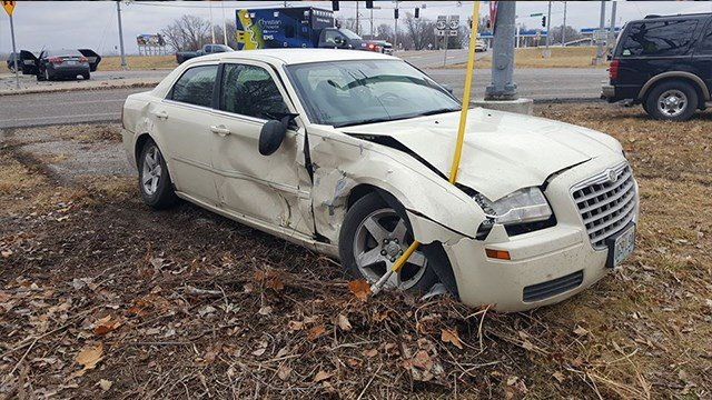 The aftermath of a T-bone accident resulting from two carjacking suspects running a red light ( Credit: KMOV)