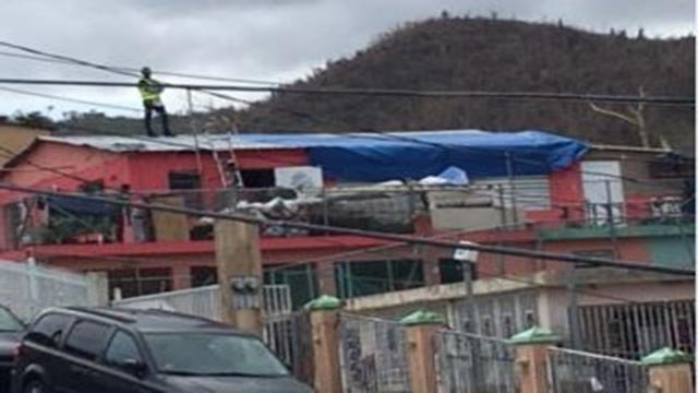 Photo of crews working on roof in Puerto Rico (Credit: Keith McMullen)