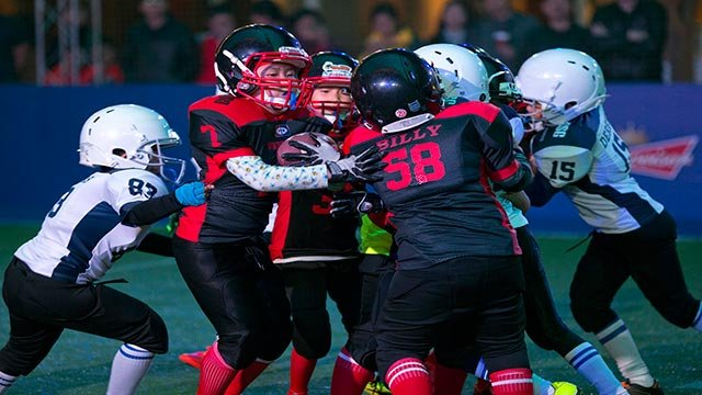 Chinese youths take part in a Youth Tackle Football game at a National Football League publicity event held in Beijing, China, Friday, Oct. 23, 2015.  (Credit: AP Photo / Ng Han Guan)