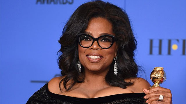 Oprah Winfrey with her Cecil B. DeMille Golden Globe she received at the 2018 awards ceremony. (Credit: AP)
