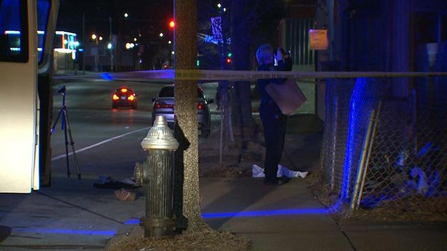 An officer investigating after 2 teenagers were shot near Fairground Park (Credit: KMOV)