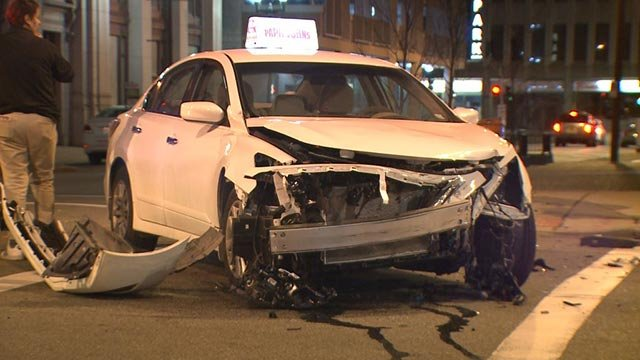 A delivery driver's car was damaged in an overnight hit-and-run in downtown St. Louis (Credit: KMOV)