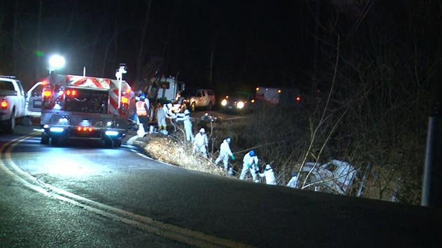Hazmat crews working after a semi-truck went down an embankment in Jefferson County (Credit: KMOV)