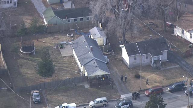 Police outside a home in Alton after a report of shots fired Friday (Credit: KMOV)