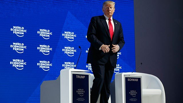 President Donald Trump walks to the podium to deliver a speech to the World Economic Forum, Friday, Jan. 26, 2018, in Davos. (Credit: AP)