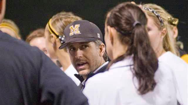 Missouri head coach Ehren Earleywine, center, talks to his team in the outfield after they defeated Washington 4-0 in an NCAA college softball game Saturday, May 28, 2011, in the NCAA Super Regionals in Columbia, Mo. (AP Photo/L.G. Patterson)