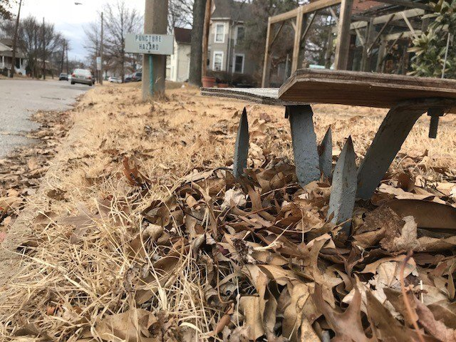 A Maplewood property owner installed steel spikes near the curb to discourage trucks from driving on the grass.