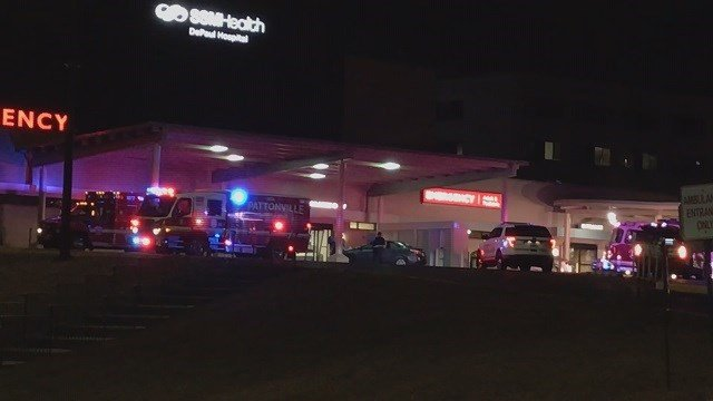Emergency crews work a scene where a car crashed into the emergency room at DePaul Hospital. (Credit: KMOV)