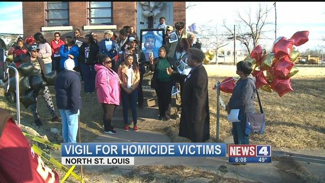 Crowd gathers at a vigil for the three woman killed escaping a home invasion (Credit: KMOV)