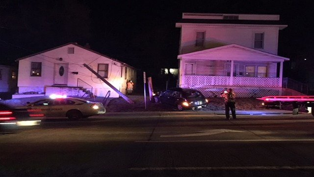 Police process the scene where a vehicle crashed into a home in Jennings, Mo.(Credit: KMOV)