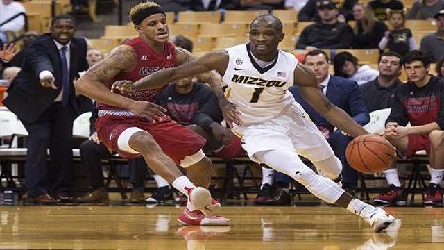 Missouri's Terrence Phillips, right, drives past Western Kentucky's Tobias Howard,  left, Saturday, Dec. 3, 2016 in Columbia, Mo. (AP Photo/L.G. Patterson)