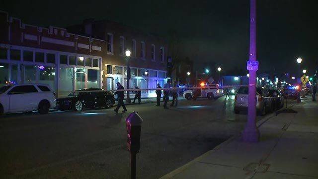 Police in the 4200 block of Manchester after a deadly double shooting early Monday (Credit: KMOV)